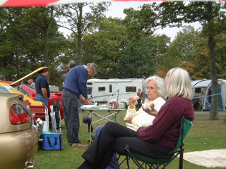 Jill and Sandy have a chat with Richard in the background working on the BBQ
