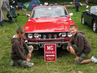 Nigel's Stag on our stand - with Thomas and Jack about to remove the MG sign.