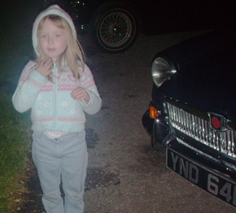 Miss Rogers with Peter's MGB